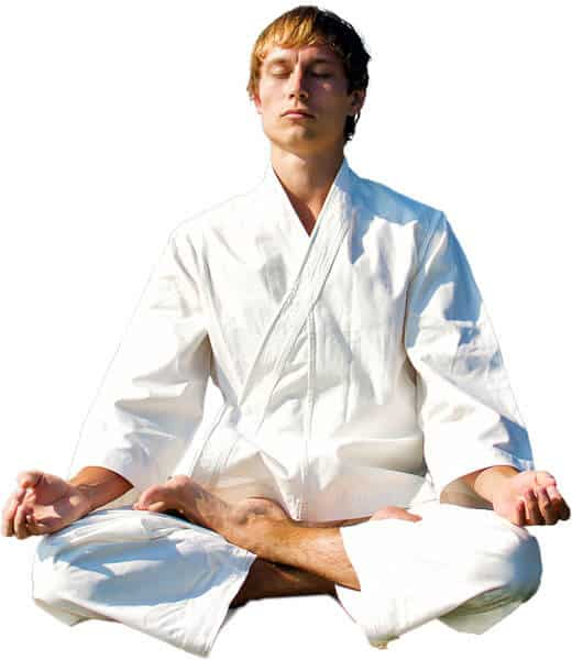 Martial Arts Lessons for Adults in Columbia MO - Young Man Thinking and Meditating in White