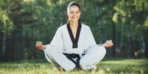 Martial Arts Lessons for Adults in Columbia MO - Happy Woman Meditated Sitting Background