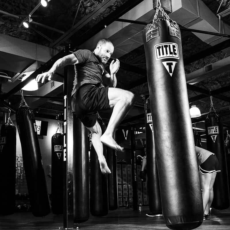 Mixed Martial Arts Lessons for Adults in Columbia MO - Flying Knee Black and White MMA